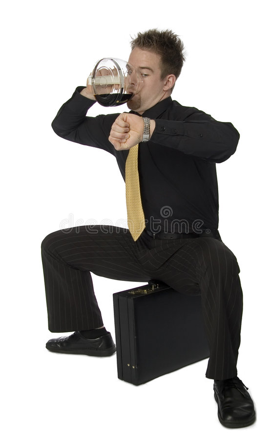 Late for work. Stressed young businessman drinking from coffeepot and checking time stock image