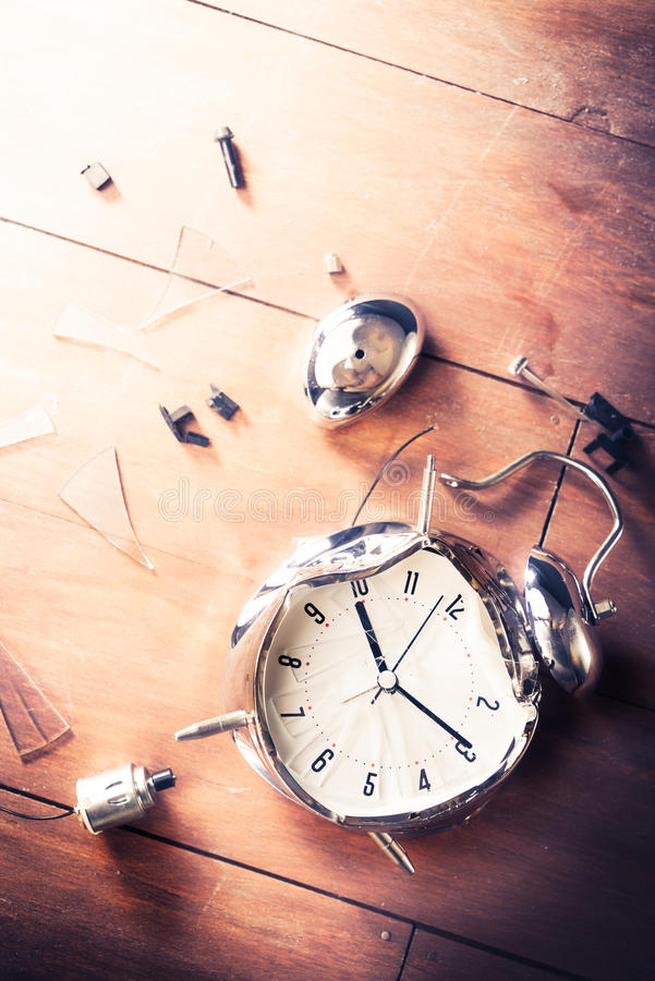 Late for work concept with destroyed alarm clock stock image