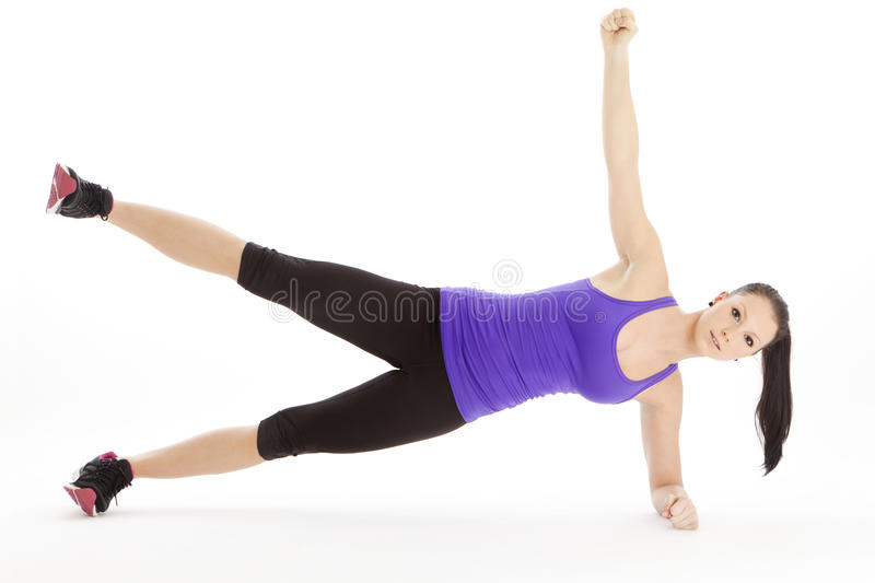 Lateral arm and leg raising. With full body tension stock image