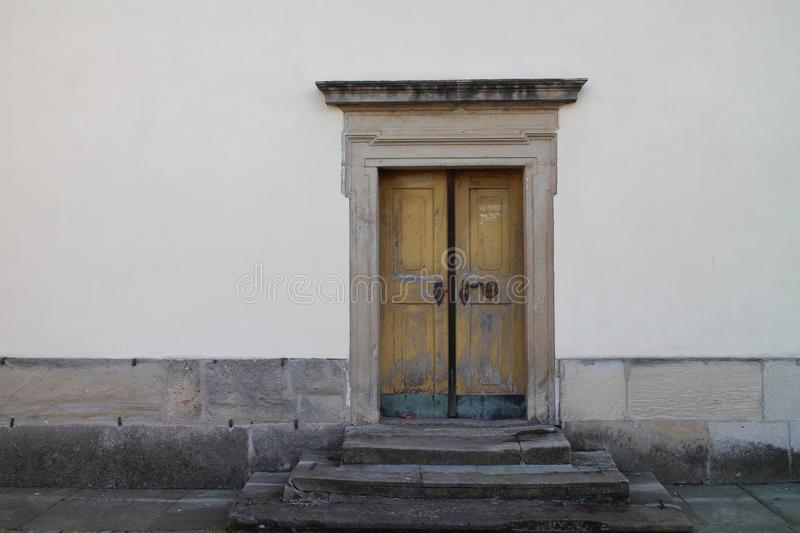 Lateral entrance to Church of the Most Holy Trinity in Fulnek. Czech republic royalty free stock photography