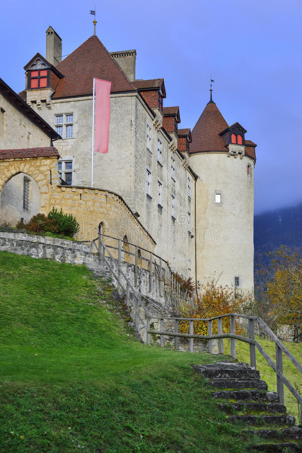 Lateral view of Gruyeres Castle. From Gruyeres village in the district of Gruyere, canton of Fribourg. Switzerland. originating from the 13th century stock image