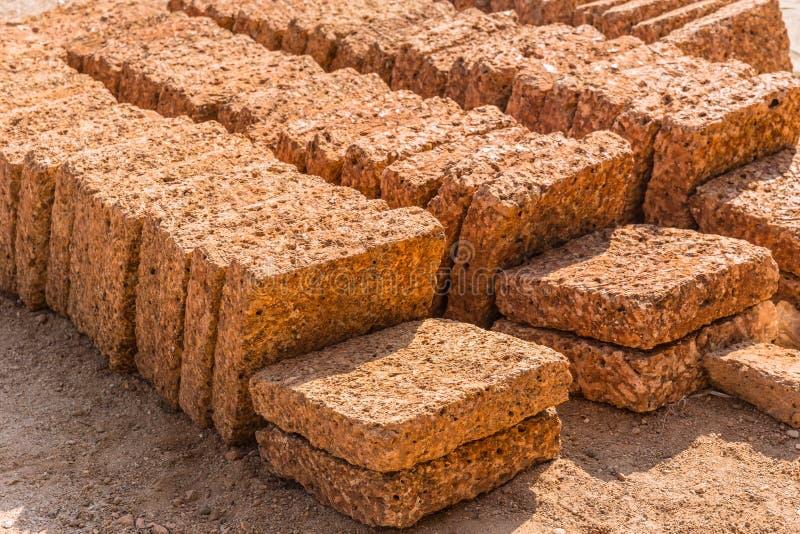Laterite rock stone bricks plate from nature reddish rusty stock photo
