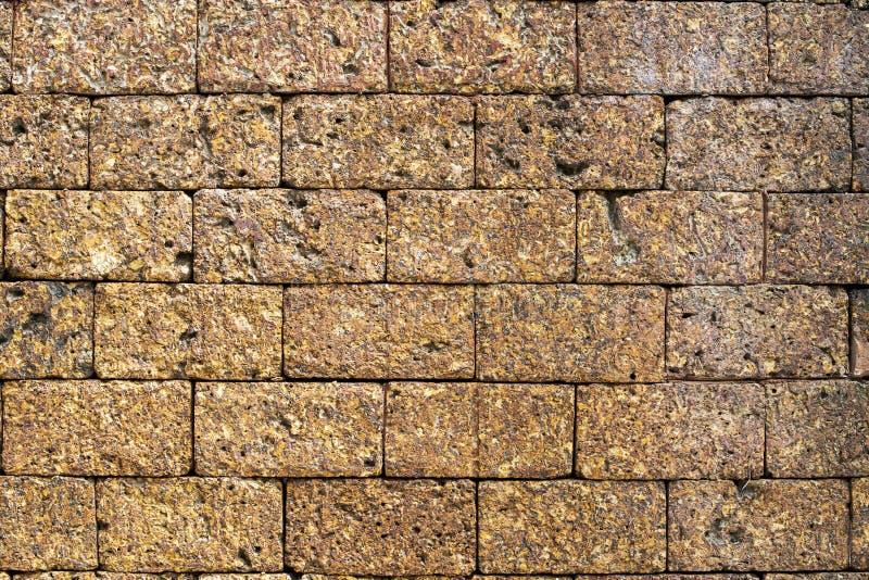 Laterite steenbakstenen muur stock afbeelding