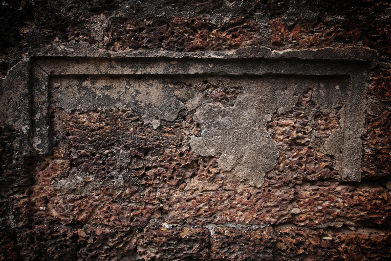 Lateritesteinbacksteinmauer lizenzfreie stockfotografie