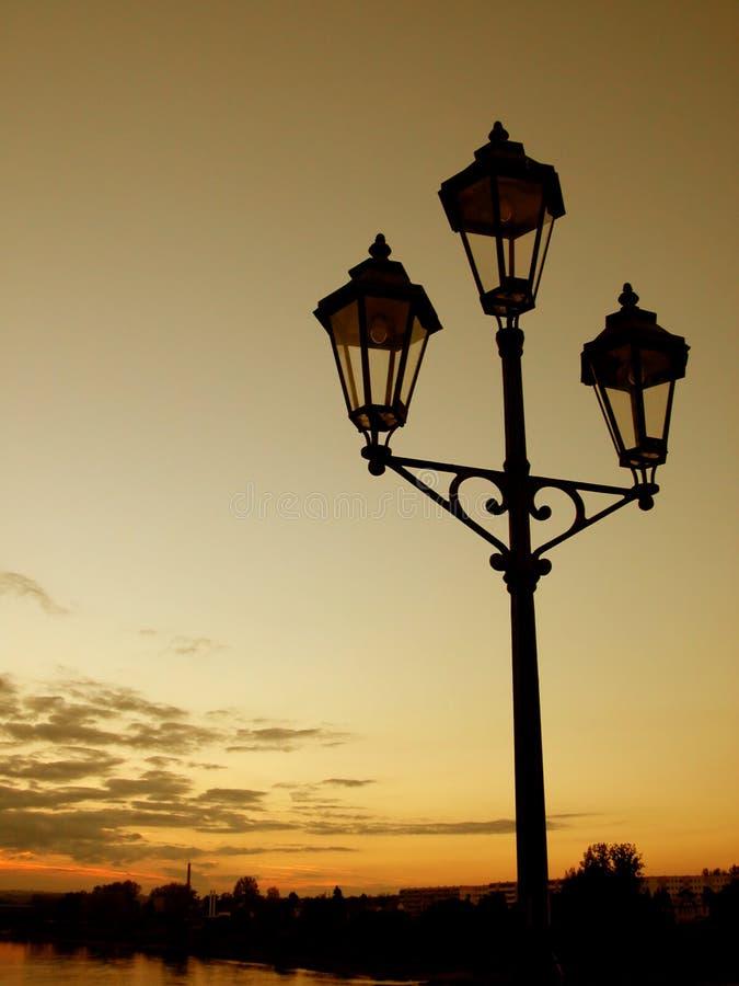 Laternenpfahl Am Sonnenuntergang Stockfotografie