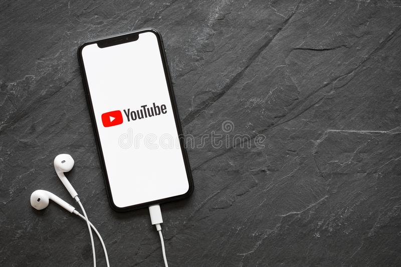 Riga, Latvia - March 25, 2018: Latest generation iPhone X with YouTube logo on the screen. Latest generation iPhone X with YouTube logo on the screen royalty free stock photography