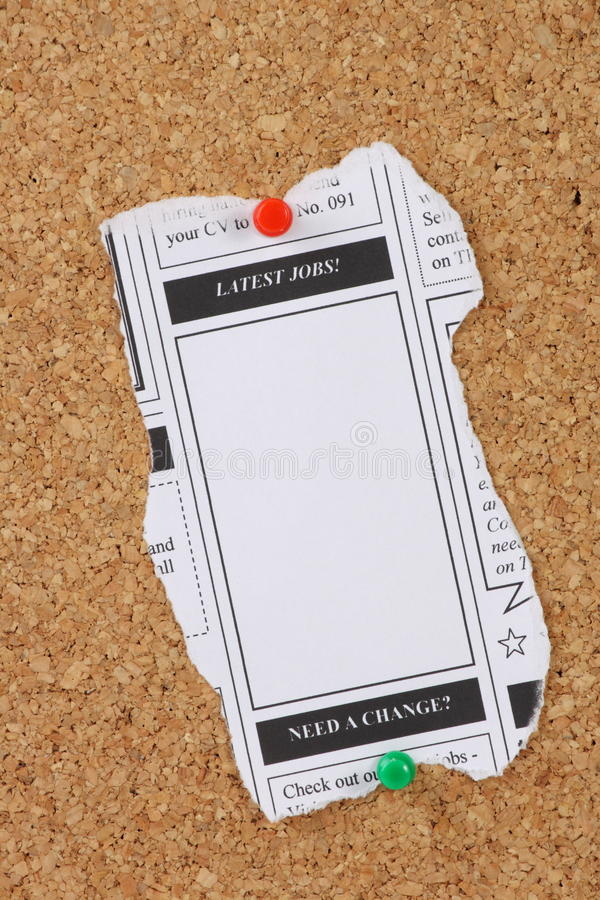Latest Jobs Newspaper Clipping. A news paper clipping with copy space advertising the latest jobs and pinned to a cork notice board stock image