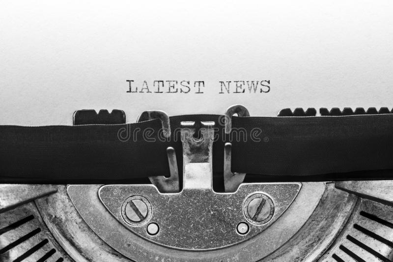 Latest news typed on a vintage typewriter stock photography