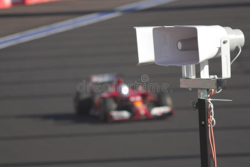 The latest sports news. Wireless speaker close up on a background of real Grand Prix Formula 1. Sports commentator broadcasting in the first rows only the latest royalty free stock photo
