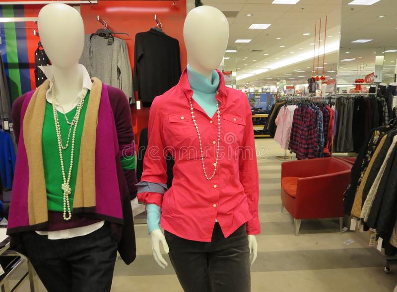 Latest womens clothing. Mannequins displaying womens latest clothes inside a store stock photography