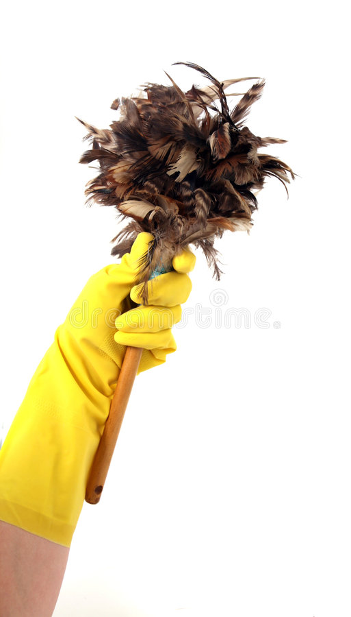Latex Glove Holding a Duster stock photography