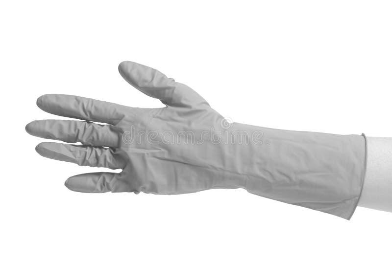 Latex-Handschuh für das Säubern auf weibliche Hand stockbilder