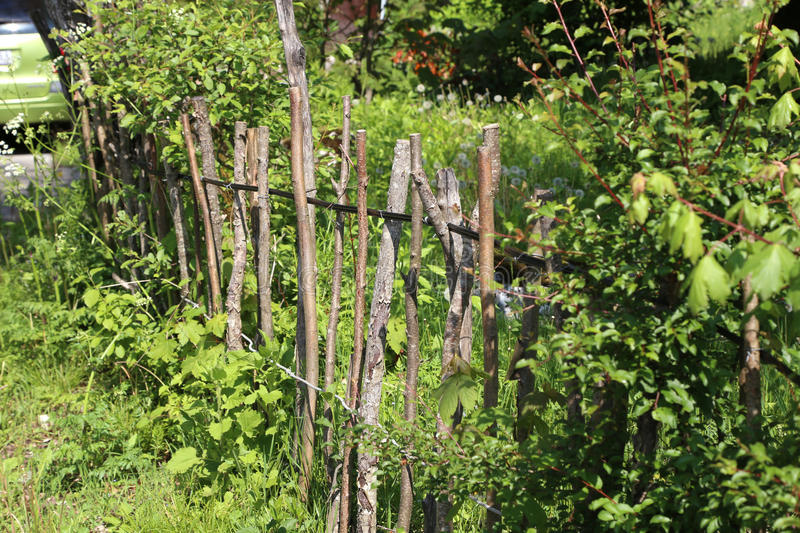 Lath fence. / Barbed wire fence on a green background royalty free stock photography
