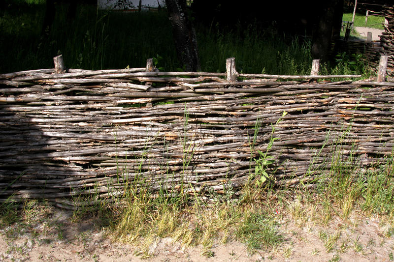 Lath fence wicker fence. Made of twigs. Life in nature. Subsistence farming. ecology. Rustic style stock photo