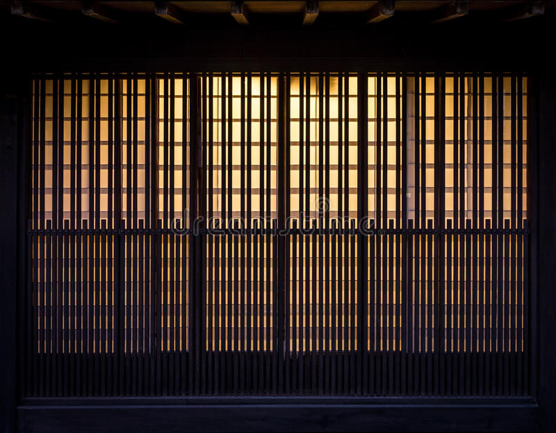 Lath wooden wall with background incandescent light stock images