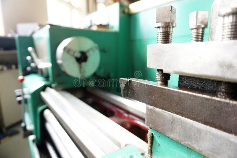 The lathe is in idle mode, the tool holder holds the tool on the guide rails.  stock photography