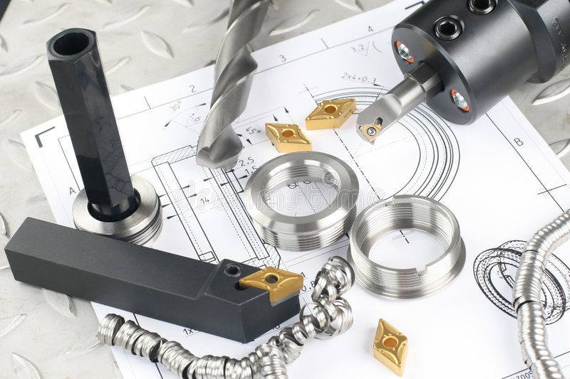 Lathe tool, drill and workpiece stock images