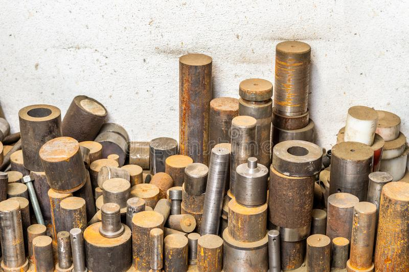 Lathed metal bar stack on factory floor. Lathed steel bar stack on factory floor royalty free stock photography