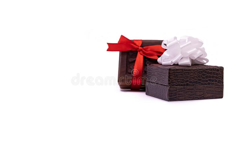 Lather and wooden gift boxes decorated with ribbons on white background royalty free stock photos
