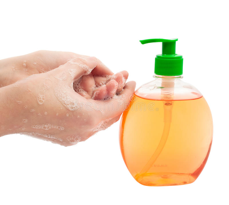 Lathered hands and liquid soap. On a white background stock images