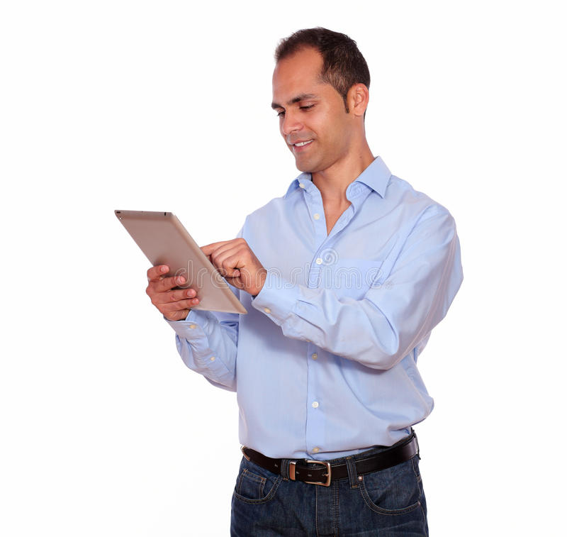 Latin adult man using his tablet pc royalty free stock photography
