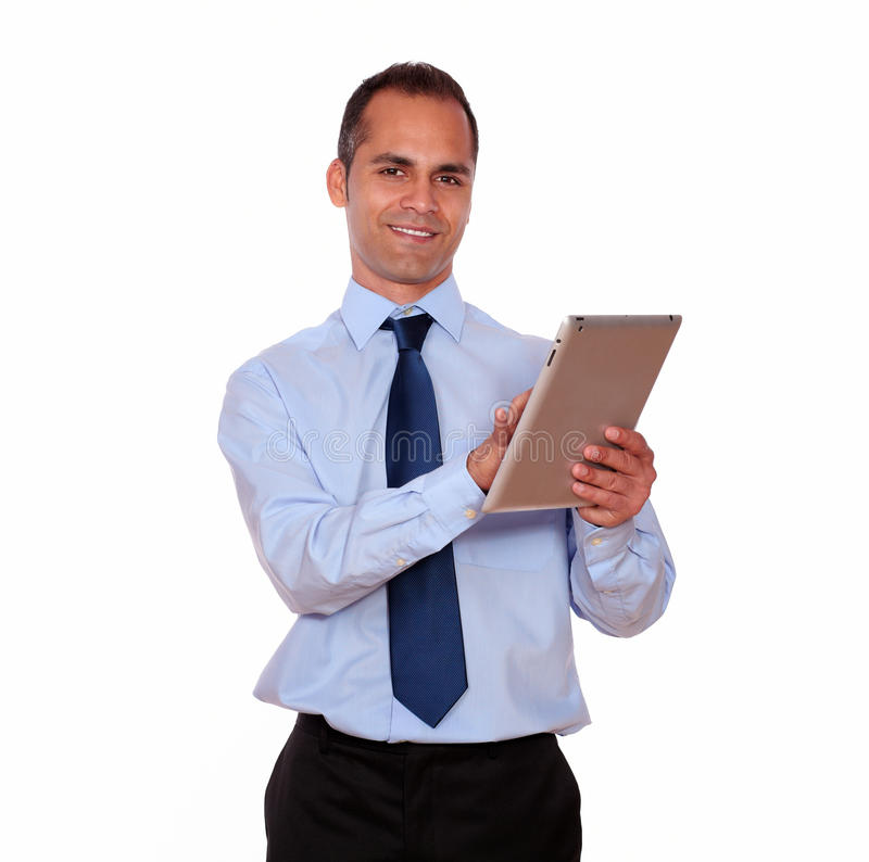 Latin adult man using his tablet pc stock photography