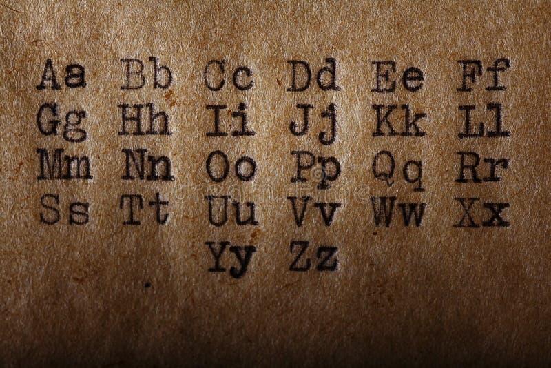 Latin alphabet, font printed on vintage typewriter. Old paper stock photo