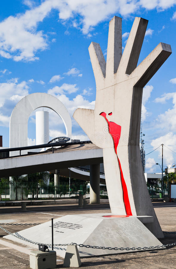 Latin America Memorial Sao Paulo Brazil. The hand with Latin America map in red blood and the curved bridge with the modern shapes in Latin America Memorial in royalty free stock image