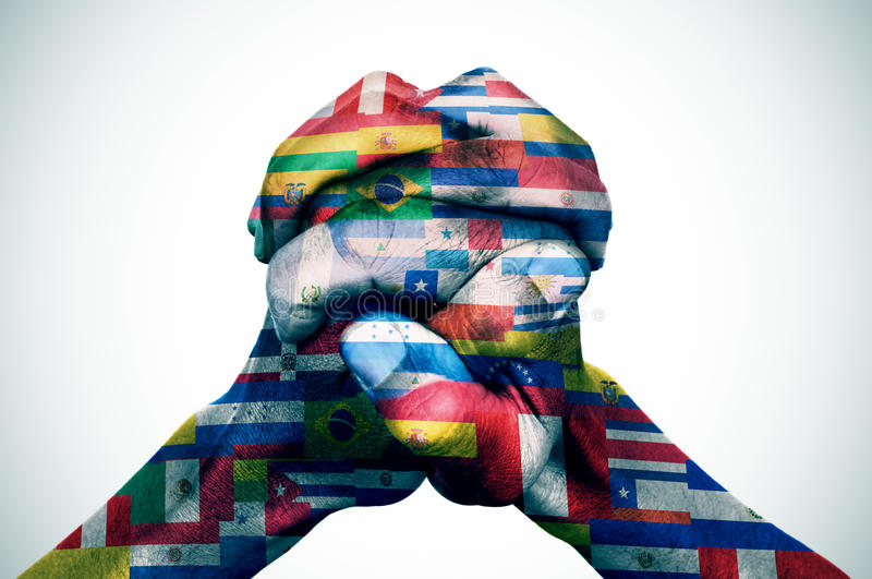 The Latin American countries. Closeup of the hands of a young man put together patterned with the flags of the Latin American countries stock photography