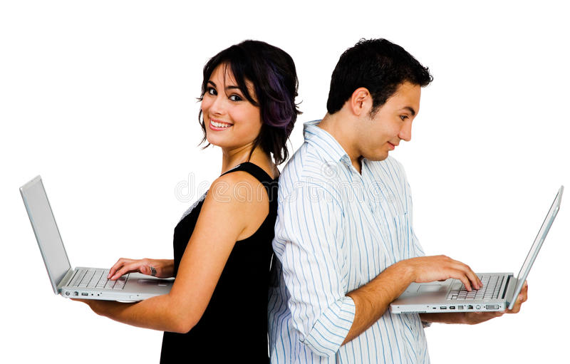 Latin American couple using laptops stock photography