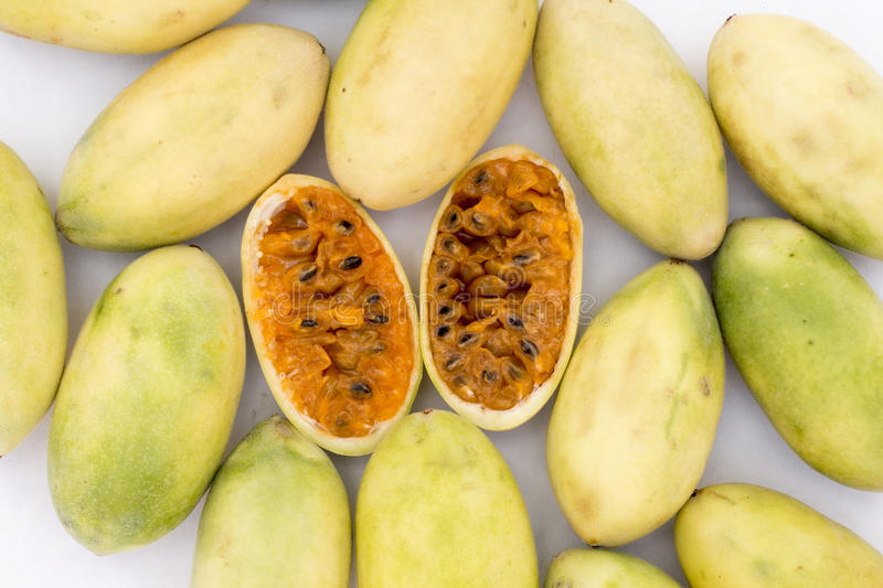 Latin American fruit called banana passionfruit (lat. Passiflora tripartita) (in Spanish mostly tumbo, curuba, taxo. Latin American fruit called banana stock images