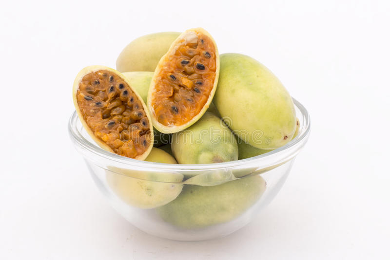 Latin American fruit called banana passionfruit (lat. Passiflora tripartita) (in Spanish mostly tumbo, curuba, taxo. Latin American fruit called banana stock image
