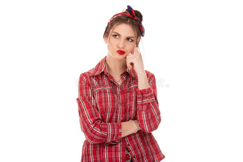 Woman thinking in looking pensive and skeptical. Latin American woman thinking in looking pensive and skeptical in casual clothes red checkered shirt looking to royalty free stock photography