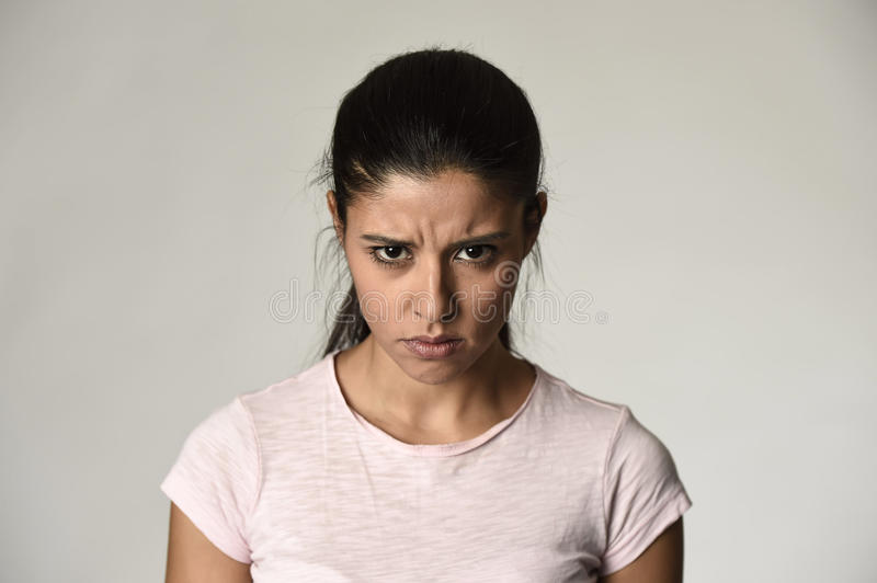 Latin angry and upset woman looking furious and crazy moody in intense anger emotion stock photos