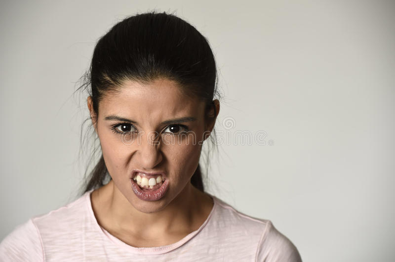 Latin angry and upset woman looking furious and crazy moody in intense anger emotion stock image