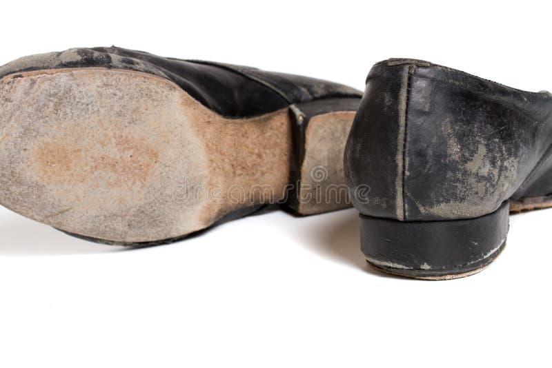 Latin ballroom dance shoes. Closeup shot of pair of worn-out latin ballroom dance shoe stock photo