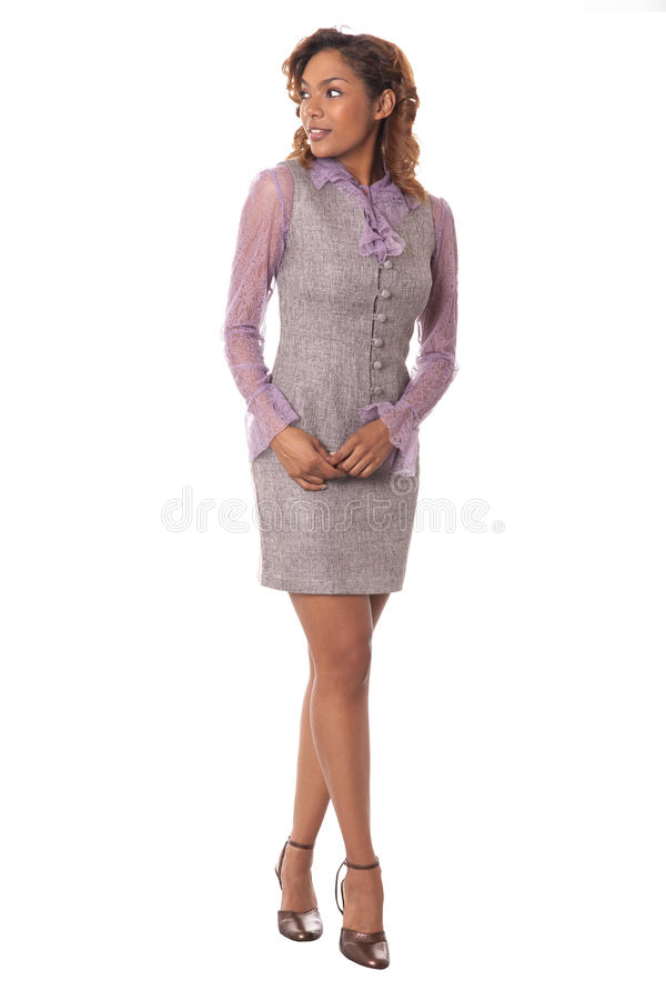 Beautiful business woman looks to the side. Latin beauty looks over her shoulder isolated on white background royalty free stock image