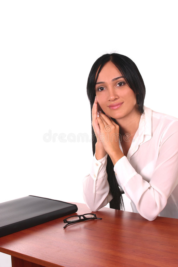 Latin business woman at the office royalty free stock photography