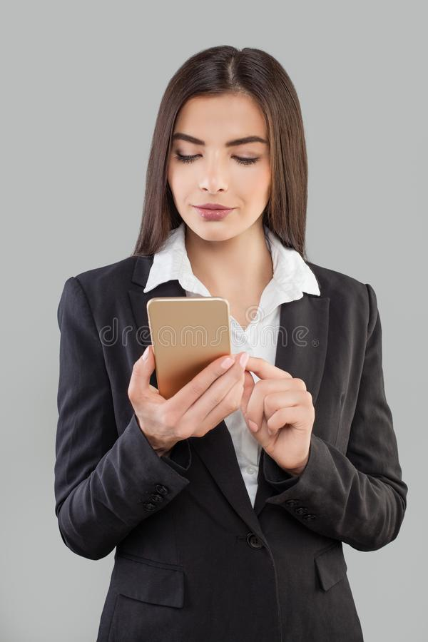 Latin Business woman with Smartphone. stock images