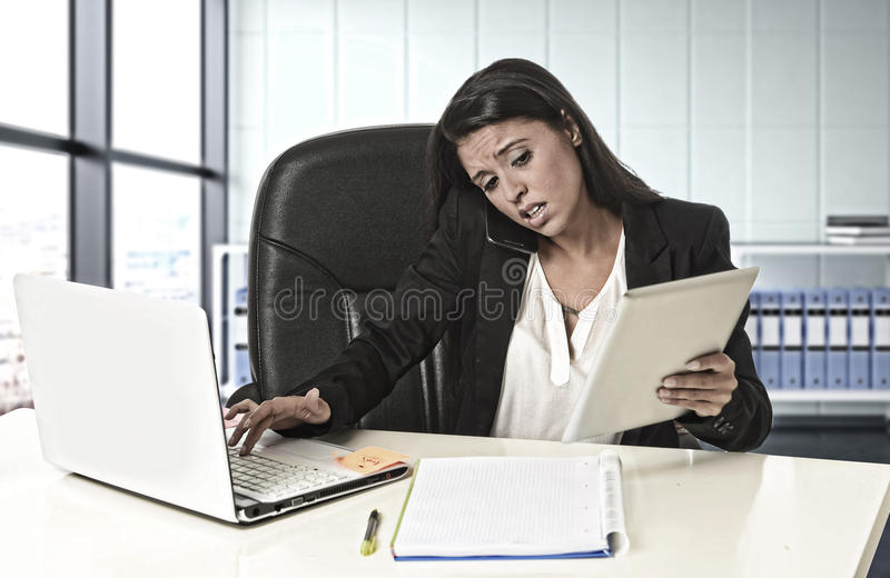 Latin business woman suffering stress working at office compute royalty free stock photos