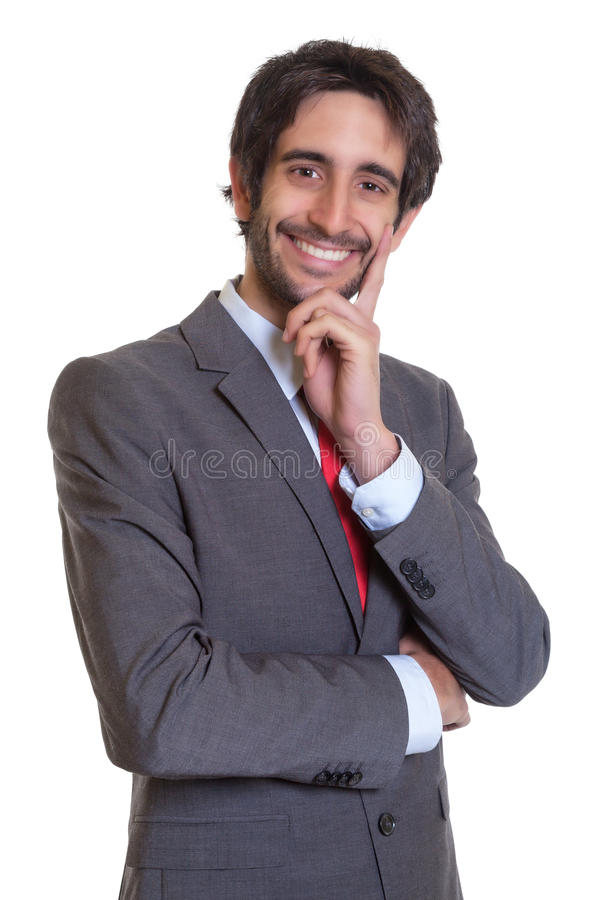 Latin businessman with beard laughing at camera. On an isolated white background for cut out royalty free stock images