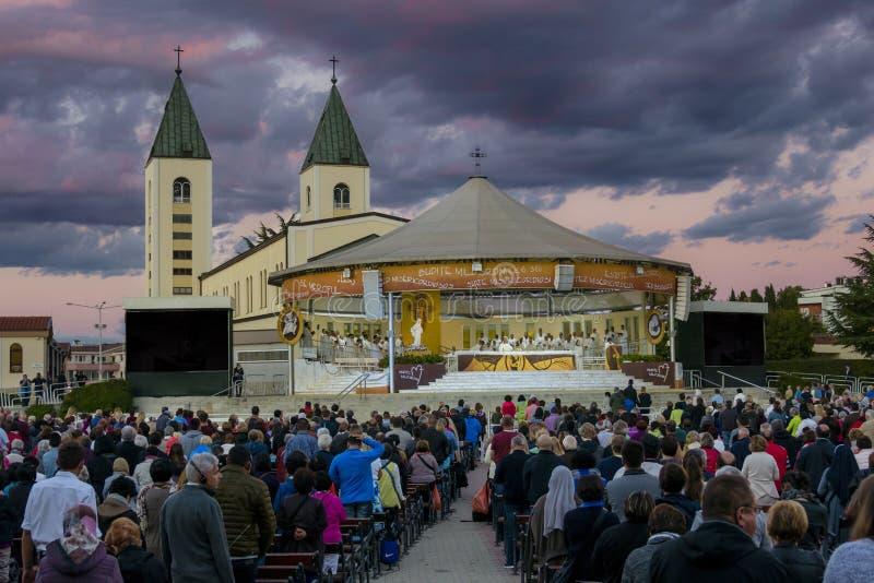 Latin Catholic Mass / Holy Service in Medjugorje stock photography