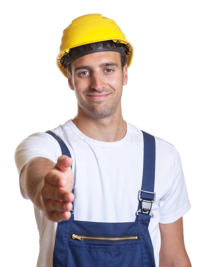 Latin construction worker reaching his hand. For a handshake on an isolated white background for cut out stock image