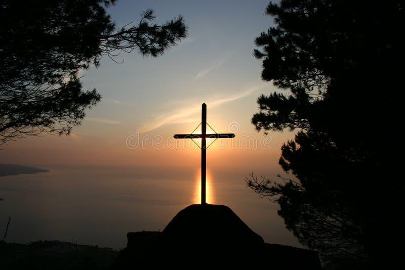 Latin cross on the sunset stock photography
