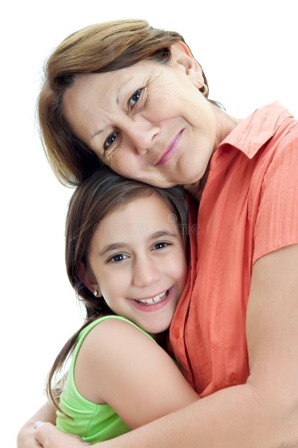 Latin Girl Hugging Her Grandmother Isolated On Whi Stock Photo