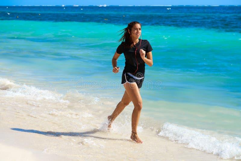 Latin girl running in caribbean shore beach. Of Mayan Riviera of Mexico royalty free stock photos