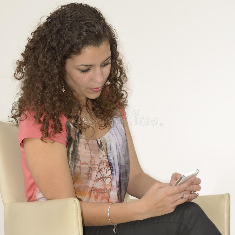 Latin girl texting stock photos
