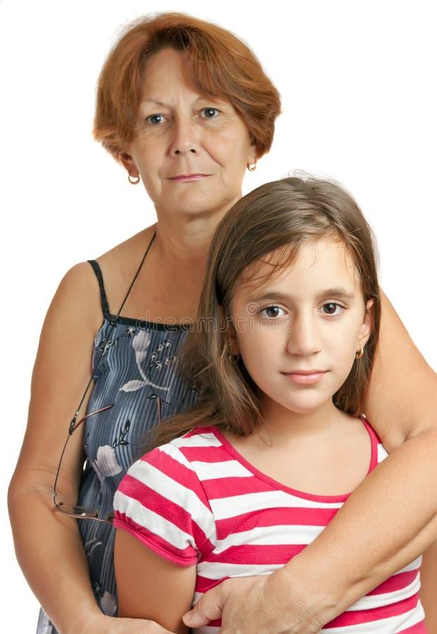 Latin grandmother hugging her granddaughter