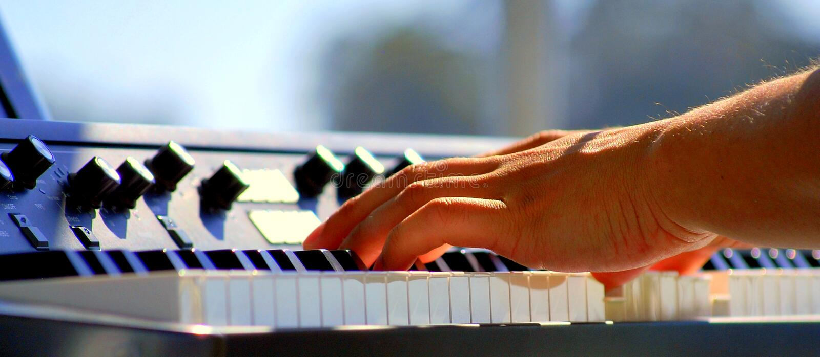Latin jazz piano. Latin jazz piano player performing a solo in concert outdoors stock image