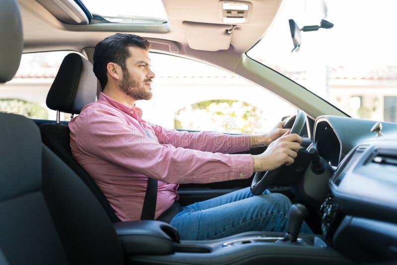 Latin Man Driving New Car stock photo